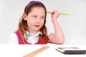 Young girl concentrating on school work